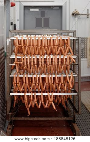 Smoked sausages cooling at food processing plant