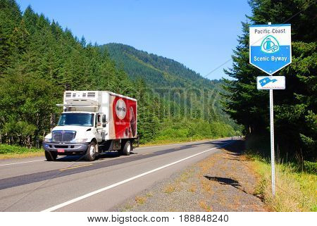 NORTHERN CALIFORNIA, USA - September 3, 2009: Haagen Dazs ice cream truck speed by a Pacific Coast Scenic Byway sign
