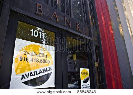 SACRAMENTO, CALIFORNIA, USA - November 14, 2009: Grubb and Ellis for sale signs in a bank doorway