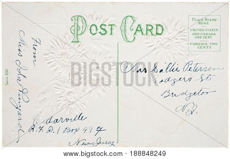 BRIDGETON, NEW JERSEY, USA - CIRCA EARLY 1900s: Unstamped post card with embossing with mailing and return addresses in ink