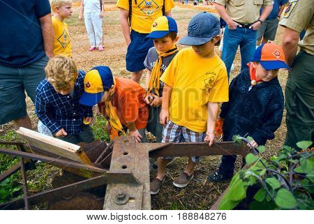 GRANITE BAY, CALIFORNIA, USA - October 18, 2009: Cub Scouts examine antique farm machinery while on a field trip to a pumpkin farm