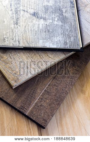 engineered tongue in groove hardwood and vinyl floor planks of various styles and finishes in a stack