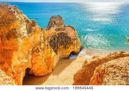 Beautiful sandy beach among rocks and cliffs near Lagos in Panta da Piedade Algarve region Portugal
