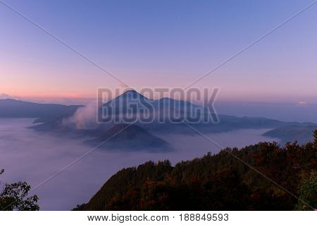 Mount Bromo volcano during beautiful sunrise from viewpoint on Mount Penanjakan.Famous for its magnificient sunrise views and the panorama over the caldera with Semeru volcano in the background.