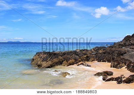Travel To Island Koh Lanta, Thailand. The View On A Beach With Stones, Sea And Blue Sky On A Sunny D