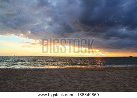 Travel To Island Koh Lanta, Thailand. The Colorful Sunset On A Beach On A Cloudy Weather.