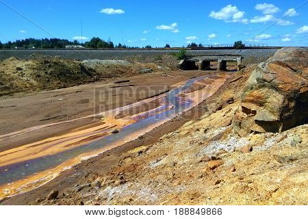 The river Sak-Yelga near to Karabash city Chelyabinsk region Russia. A view on the polluted river under the bridge.