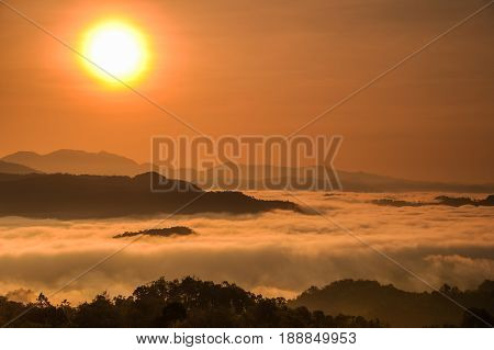 Sea of mist in between mountains with sunrise