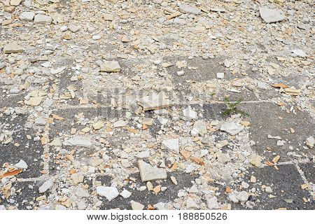 Construction and demolition debris on the pavement