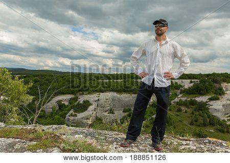 Tourist on the plateau of the Cave City in Cherkez-Kermen Valley, Crimea