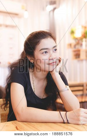 beauty asian woman long black hair with black shirt sitting at chair indoor photo vintage tone