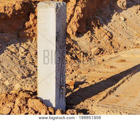 Concrete pile foundation for the building. Reinforced concrete piles on new construction site.