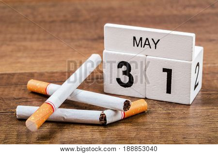 31th MAY and tobacco on wooden background. World No Tobacco Day
