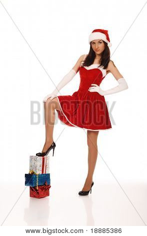 pretty young teenager in red christmas clothing, isolated on white. good use for christmas cards and posters