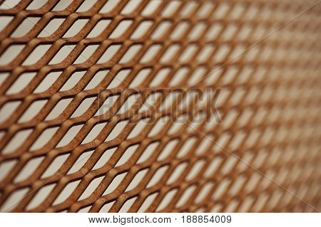 Old rusty mesh in blurring. Colorful pattern. Metal rusty fences.