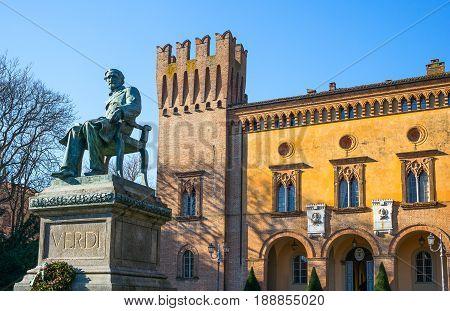 Busseto Italy - November 29 2013: The Giuseppe Verdi monument in front of the Pallavicino Rocca