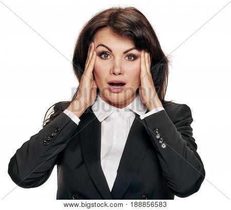 Portrait of sad shocked business woman touching head