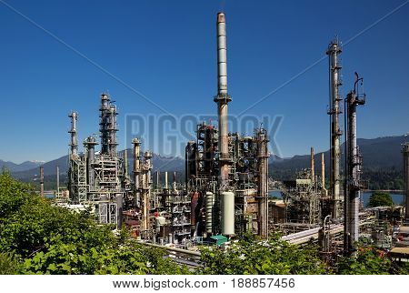 Oil refinery on a background of nature, Burrard Inlet and mountain view