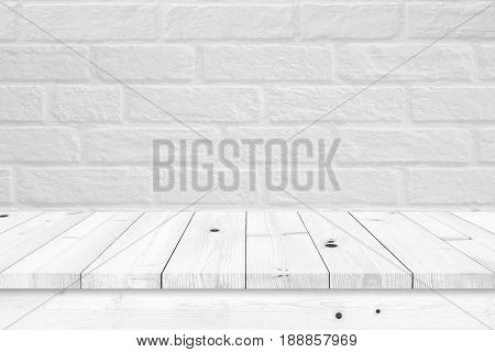 Empty wooden table with white brick wall background. For display or montage your products.