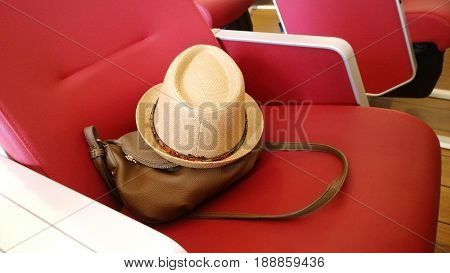Forgotten handbag and a summer straw hat on the seat