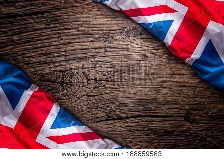 Flag of United Kingdom on old wooden background. Union Jack flag on old oak background.