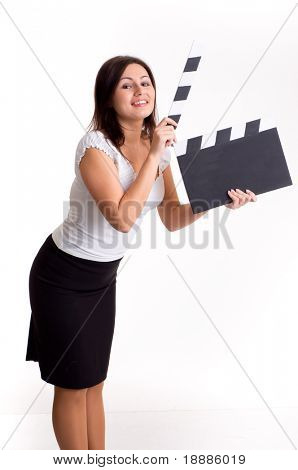 Pretty young woman holding a clapper, isolated on white