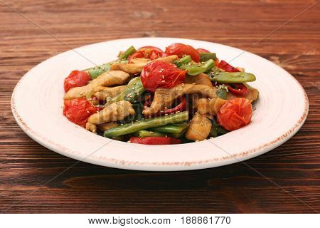 Stewed chicken breast with green bell pepper, young peas and tomatoes. Low carb healthy eating concept.