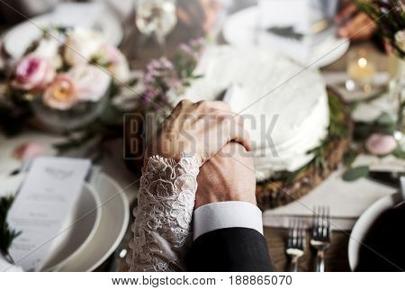 Bride and groom cutting wedding cake together