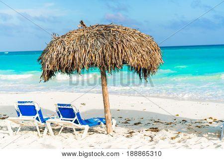 Beautiful tropical beach and Caribbean sea with sunbeds