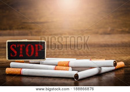 STOP 31 May World No Tobacco Day on wooden background.
