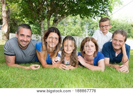 Family Of Six 6 Lying On The Grass Happy And Cheerful