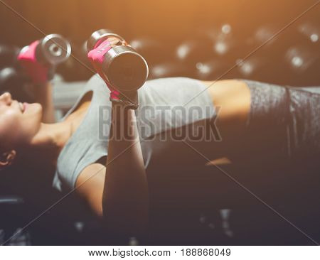 Slim, Bodybuilder Girl, Lifts Heavy Dumbbell Standing In Front Of The Mirror While Training In The G