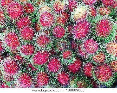Fresh rambutan sweet delicious fruit, colorful background, Thailand fruit.