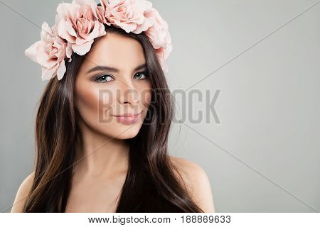 Glamorous Woman with Perfect Makeup and Summer Rose Flowers on Gray Background