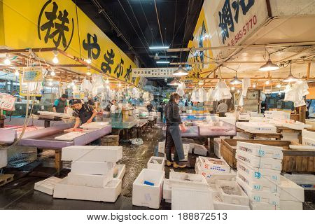 TSUKIJI TOKYO, JAPAN - NOV 30 Merchants sale seafood in Tsukiji fish market on November 30, 2016 in Tsukiji, Japan. Tsukiji fish market is one of biggest fish market in the world