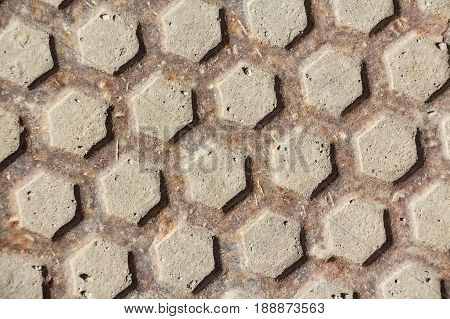 Closeup metal manhole with grid pattern abstract background