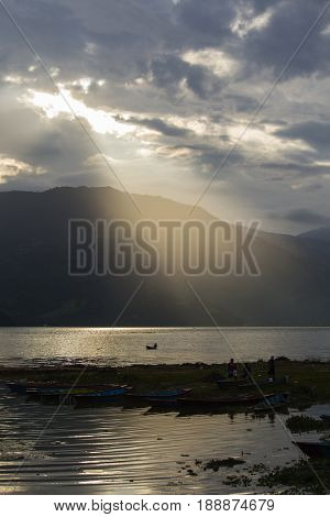 Sunset in lake Phewa in Pokhara Nepal with the Himalayan mountains in the background