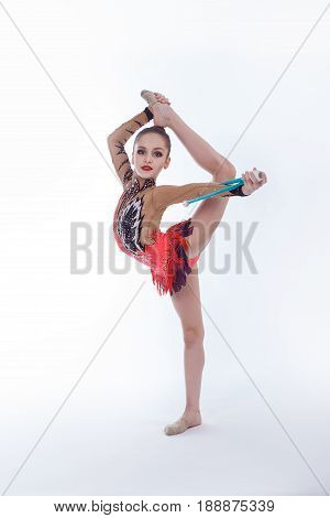 Young gymnast doing exercises with a mace