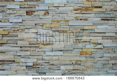 Light brown rough flat stones wall pattern