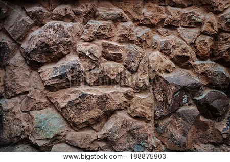 Old brown stones wall pattern useful as background