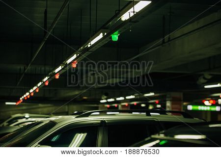 Car parking with sensors and electronic information displays. Technology transport.