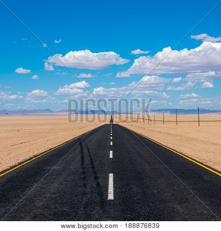 vibrant image of highway and blue cloudy sky