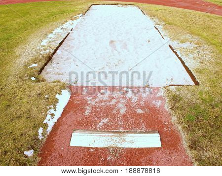 Lane For The Long Jump. Sandy Red Retrack, White Ake-off Board.