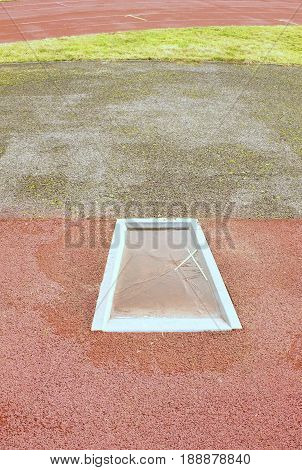 Detail Of Take-off Board On Track And Field For Pole Vault High Jump. Winter Season