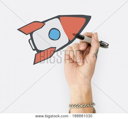 Hand writing board with rocket start up icon
