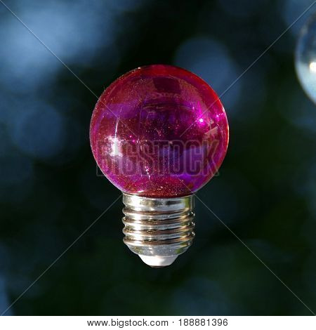 Red vitreous bulb on dark blue background