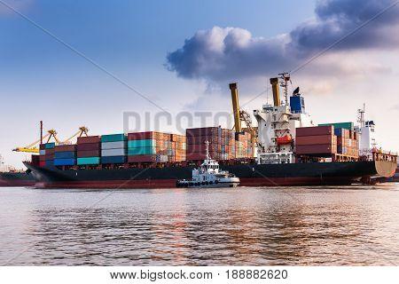 Container shipping at Bangkok pier. Cargo ship terminal.