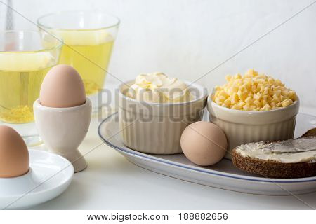 Healthy organic breakfast, boiled eggs with bread
