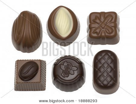 Assortment of milk and dark chocolates isolated on white background