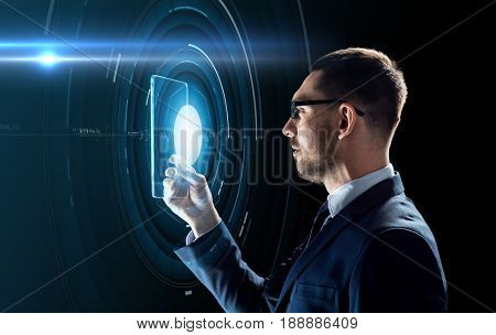 business, augmented reality and future technology concept - businessman in glasses working with transparent tablet pc computer and hologram over black background